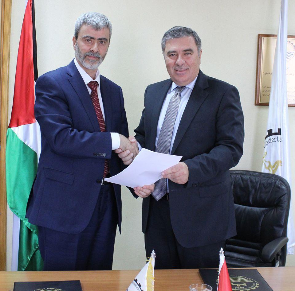 المصلحة وبنك فلسطين يوقعان اتفاقية تسديد بواسطة بطاقات الائتمان